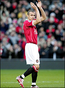 Henrik Larsson acknowledges the crowd as he is introduced for his Manchester United debut