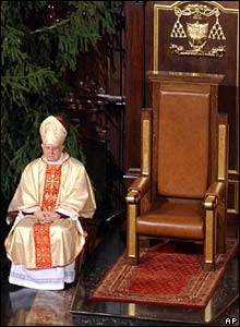 Archbishop Wielgus beside empty throne