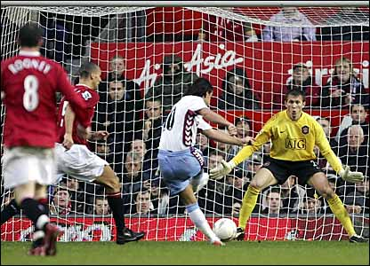 Milan Baros (centre) scores Aston Villa's equaliser past Manchester United goalkeeper Tomasz Kuszczak (right)