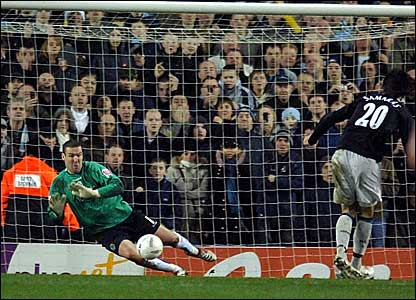 Sheffield Wednesday goalkeeper Mark Crossley (left) guesses the right way but cannot stop Georgios Samaras' penalty