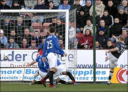 Jim Hamilton (right) scores Dunfermline's first against Rangers