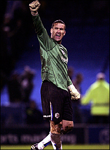 A bruised and battered Sheffield Wednesday goalkeeper Mark Crossley salutes the crowd