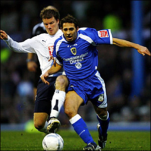 Cardiff's Michael Chopra (foreground) is put under pressure by Tottenham's Teemu Tainio