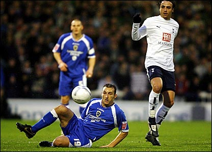 Cardiff's Riccardo Scimeca (left) and Tottenham's Dimitar Berbatov battle for the ball