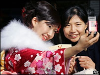 A young woman in kimono and her mother smile together for a photograph 8/1/2007