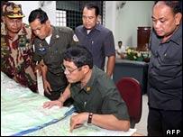 Air Force staff look at charts