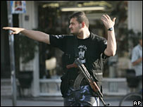 A Hamas member directs traffic in Gaza City. File photo