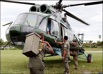 Cambodian rescuers board a helicopter in Kampot province