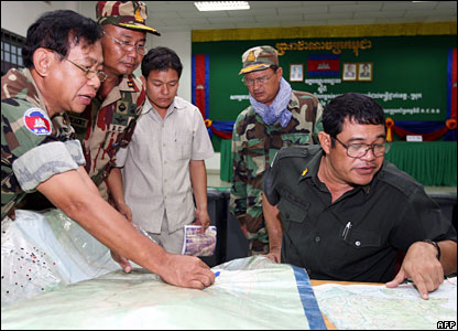 Cambodian royal armed forces commander Ke Kimyan (R) looks at a map to locate the charter plane AN-24 in the jungle in Kampot province