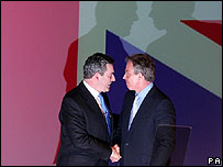 Tony Blair shakes hands with Gordon Brown