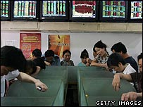 Chinese investors study stock market movements