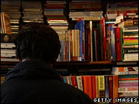 A man looks at books