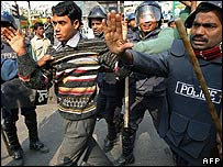 Police arrest a supporter of the Awami League and its allies
