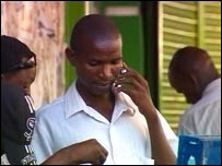 Kenyans using their handsets, BBC