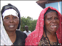 Women cry after seeing the dead bodies