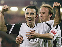 Swansea's Leon Britton and Paul Butler each scored as their side knocked Premiership side Sheffield United out of the FA Cup