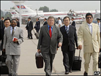 International Atomic Energy Agency Director General Olli Heinonen, centre, walks with UN nuclear inspectors upon arrival in Pyongyang