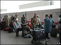People waiting to enter a holding area in the middle of last December's fog chaos at Heathrow