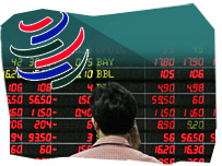 Man looking at stock exchange panel and WTO logo