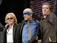 REM's Mike Mills, Michael Stipe and Peter Buck