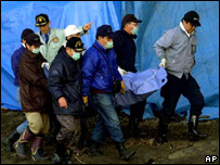Police take Lucie's remains away from the cave