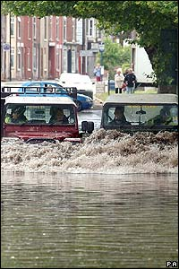 Drivers use 4x4 vehicles to get through the floods