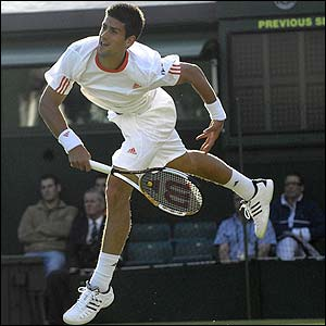 Novak Djokovic serves to Potito Starace
