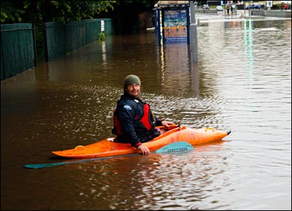 Canoe in the floods. Copyright: Adam Broadhead