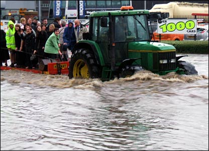 Tractor rescuing people. Copyright: Kevin Burt