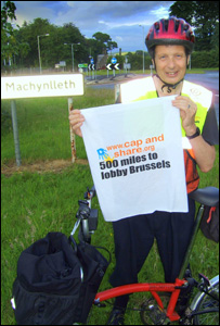 Dr Will Howard with his bike ready to set off, photo: Robert Ayres
