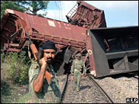 Indian police at the site where a goods train was blown up by a land-mine by Maoists rebels in Jharkhand state on 26 June 2007
