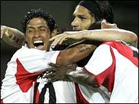 Peru's Juan De La Haza (left) celebrates their third goal with team-mates