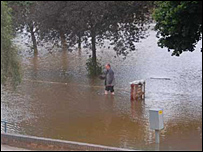 A man paddles in the flooded Hylton Road area of Worcester