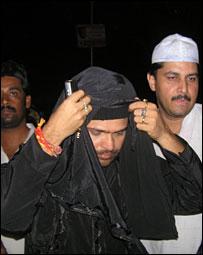 Himesh Reshammiya in a burqa inside a Muslim shrine