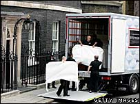 Removal men put Tony Blair's possessions in a lorry