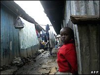 A boy stands outside his house in a slum in the Kenyan capital, Nairobi (file picture)
