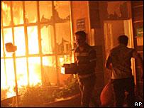 Iranians torch a petrol station in Tehran