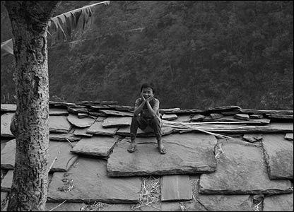 Boy on roof in Mahabir village
