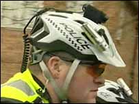Police officer with camera on headgear