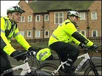 Officers on cycles patrol the estate streets