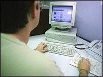 Man at computer terminal
