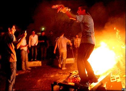 Man dancing atop flames