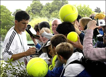 Tim Henman signs autographs