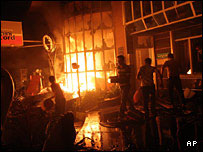Iranians burn a gas station during a protest against gas-rationing in Tehran.