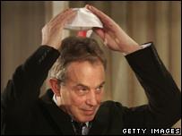 Former British Prime Minister Tony Blair puts on a traditional Jewish skull cap