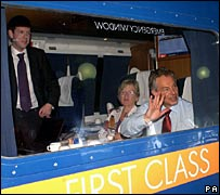 Tony Blair waves from a train window