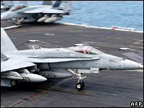 A handout picture released by the US navy shows an F/A-18C Hornet landing