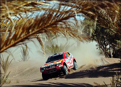 Japan's Hiroshi Masuoka and French co-driver Pascal Maimon steer their Mitsubishi during the fourth stage of the Dakar Rally between Er-Rachidia and Ouarzazate in Morocco