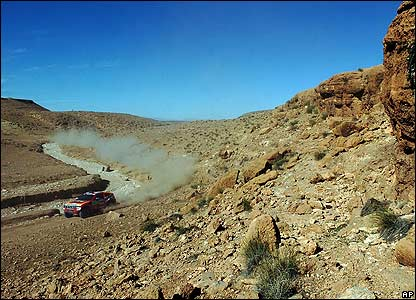 Spanish team Joan Roma and Luca Cruz Senra steer their Mitsubishi during the third stage of the Dakar Rally between Nador and Er-Rachidia, Morocco