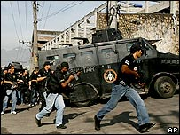 Armed police in a Rio de Janeiro slum